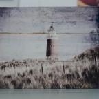 Holzlatten mit Leuchtturm